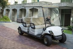 Electric golf car in the summer resort. stock photo