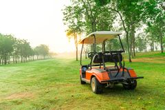 Goft cart within Golf court in the morning. An Electric golf cart in a long green golf court, Pattaya, Thailand Royalty Free Stock Image