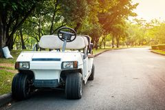 Electric golf cart without roof on the road.  Stock Image