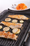 Electric grill. Lake of salmon on fried elektrogrill Royalty Free Stock Image
