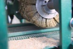 Electric grinder machine. Wood factory. Wood Shavings, Grinding Royalty Free Stock Photo