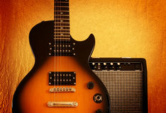 Electric guitar. And amplifier on vintage background Stock Photography