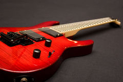 Electric Guitar. Red Electric Guitar on Black Background Stock Image