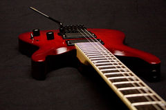 Electric Guitar. Red Electric Guitar on Black Background Royalty Free Stock Photography