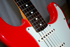 Electric guitar. Part of a red electric guitar Royalty Free Stock Image