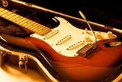 Electric Guitar. On case with orange lighting Stock Photography
