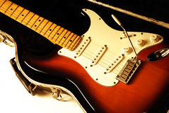 Electric Guitar. On case with orange lighting Stock Image