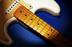 Electric guitar. Closeup of an electric guitar on blue stock photo