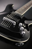 Electric Guitar. Black Electric Guitar with white edge with reflection royalty free stock photography