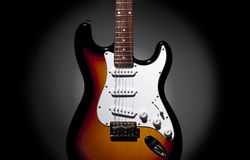 Electric Guitar. On black background with circular vignette Royalty Free Stock Photography