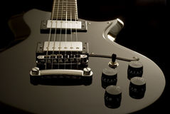 Electric guitar. Details of the body and strings on an electric guitar stock photography