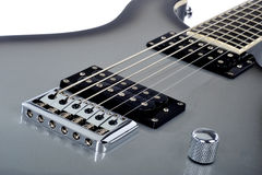 Electric guitar. Closeup of stylish grey or gray electric guitar with white background Stock Photo
