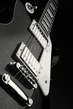 Electric guitar. Detail of an electric guitar in black and white Royalty Free Stock Photo