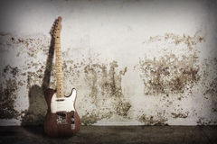 Electric guitar. On grunge scene Royalty Free Stock Photo