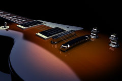Electric guitar. On a black background Royalty Free Stock Photography