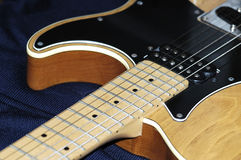 Electric guitar. Neck & body of an electric guitar Royalty Free Stock Photos