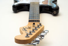 Electric guitar. A shot looking down an electric guitar with a narrow depth of field Royalty Free Stock Photography