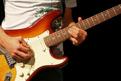 Electric Guitar. An Electric Guitar player strums his instrument Royalty Free Stock Photo