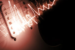 Electric guitar. Playing electric guitar with lights Stock Photos