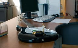 Electric guitar. On the workplace of manager Stock Photography