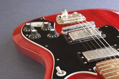 Electric guitar. Red electric guitar on gray back ground Stock Photos