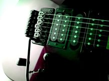 Electric Guitar. Under Green & Purple Lights Royalty Free Stock Images