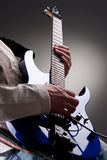 Electric guitar. Detail of mans hands playing electric guitar Stock Images