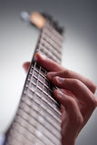 Electric guitar. Detail of mans hands playing electric guitar Royalty Free Stock Photos