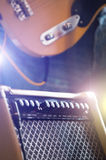Electric guitar with amp Stock Photo