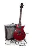An electric guitar and amp on a white background with copy space Stock Image