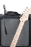 Electric guitar with amplifier and audio cord with jack Stock Photo