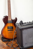 Electric guitar and amplifier with cable Royalty Free Stock Photos