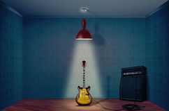 Electric guitar. And amplifier on a empty room Royalty Free Stock Photos