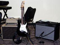 Electric Guitar With Amps And Mic Setup For Performance. Electric Guitar In Stand With Two Amps And A Microphone Setup For Indoors Performance stock images
