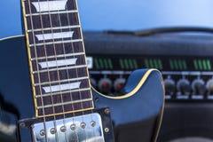 Electric guitar. Black electric guitar and amplifier Stock Photos