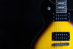 Electric Guitar on black background Royalty Free Stock Images