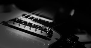 Electric Guitar. Black and white low key electric guitar close-up Royalty Free Stock Photography