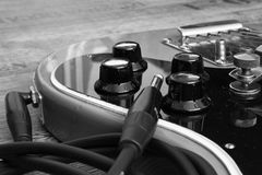 Electric guitar. Black and white photos of the electric guitar into the amplifier royalty free stock photo