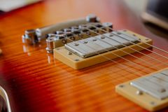 Electric guitar body and neck detail on wooden background vintage look royalty free stock images