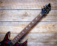 Electric guitar body on wooden board background Royalty Free Stock Photography