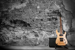 Electric guitar on a brick wall background Stock Photos