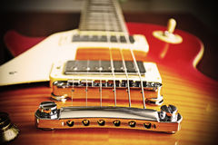 Electric guitar bridge in vintage effect Royalty Free Stock Images