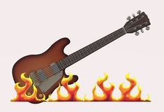 An electric guitar with burning flames in the foreground royalty free stock images
