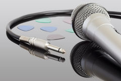 Electric guitar cable and microphone. Microphone and audio jack cable. Can be used in a music concept Stock Image