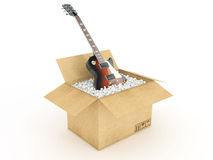Electric guitar in cardboard box Royalty Free Stock Image