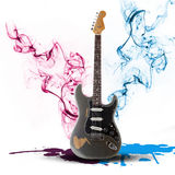 Electric guitar concept surrounded with smoke and splash Royalty Free Stock Photos