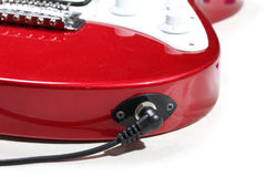 Electric guitar connected by cable Royalty Free Stock Photography