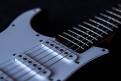 Electric guitar on dark background stock photo