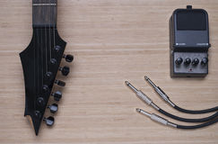 Electric guitar and distortion unit Royalty Free Stock Image