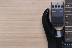 Electric guitar and distortion unit Stock Photography